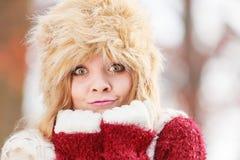 Portrait of pretty fashion woman in fur winter hat Stock Photos