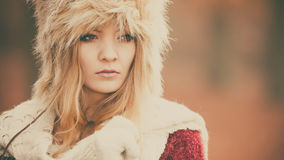 Portrait of pretty fashion woman in fur winter hat Stock Image