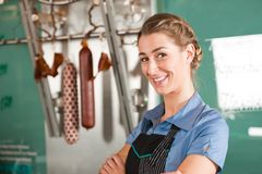 Smiling Female Butcher at Butchery Stock Photos