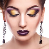 Portrait of pretty female with closed eyes and multicolored make Royalty Free Stock Photography