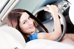 Portrait of pretty female driver. Turning back Stock Image
