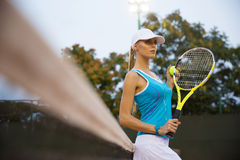 Portrait of a pretty female tennis player Royalty Free Stock Image