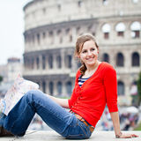Portrait of a pretty, female tourist in Rome. Portrait of a pretty, young, female tourist in Rome, Italy (with Colosseum in the background royalty free stock photo