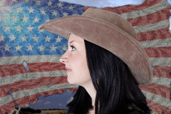 Portrait of a pretty girl on a  American flag Royalty Free Stock Image