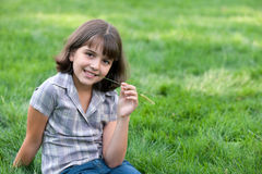 Portrait of a pretty girl with a blade of grass Stock Photos