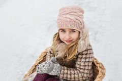 Portrait of a pretty girl in a checkered beige coat and light pink hat Royalty Free Stock Photography