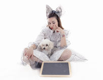 Portrait of pretty girl dressed funny clothes. And her little dog Royalty Free Stock Images