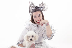 Portrait of pretty girl dressed funny clothes. And her little dog Royalty Free Stock Photos