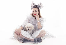 Portrait of pretty girl dressed funny clothes. And her little dog Stock Photography