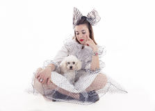 Portrait of pretty girl dressed funny clothes. And her little dog Stock Images