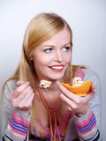 Portrait of pretty girl eating cake Stock Photography