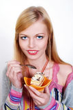 Portrait of pretty girl eating cake Royalty Free Stock Images