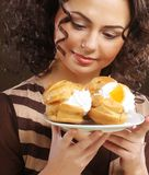 Portrait of pretty girl eating cake Royalty Free Stock Photography
