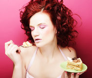 Portrait of pretty girl eating cake, close up Stock Photography