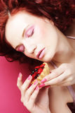Portrait of pretty girl eating cake, close up Royalty Free Stock Photo