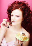 Portrait of pretty girl eating cake, close up Stock Photos
