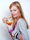 Portrait of pretty girl eating cake with pleasure Royalty Free Stock Photo