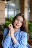 Portrait of pretty girl with everyday makeup and wearing jeans shirt. Concept of beauty and appearance Royalty Free Stock Photo