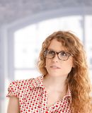 Portrait of pretty girl front of window in glasses Stock Photography