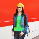 Portrait of pretty girl in glasses wearing a bright casual cloth Stock Photos