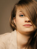 Portrait of pretty girl with hair fringe covered eye Royalty Free Stock Photography