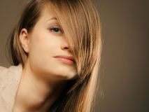 Portrait of pretty girl with hair fringe covered eye Royalty Free Stock Image