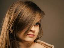 Portrait of pretty girl with hair fringe covered eye Stock Photography