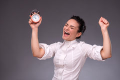 Portrait of pretty girl holding an alarm clock in Royalty Free Stock Photo