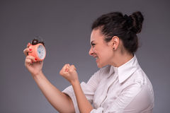 Portrait of pretty girl holding an alarm clock Royalty Free Stock Image