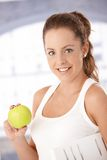 Portrait of pretty girl holding an apple smiling Stock Photo