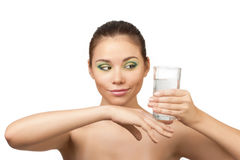Portrait of pretty girl holding a glass of water Stock Images