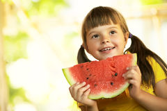 Girl with a piece of watermelon Royalty Free Stock Image
