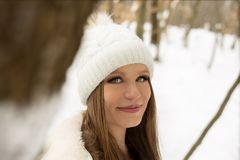 Portrait of a pretty girl looking in to the camera in a winter f stock photos