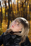 Portrait of pretty girl looking upward. In autumn park Royalty Free Stock Photos