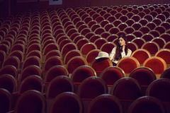 Portrait of a pretty girl in a movie theater Royalty Free Stock Photos