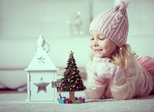 Portrait of pretty girl with new years tree and flashlight Royalty Free Stock Images