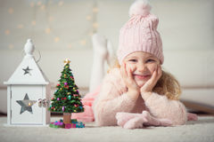 Portrait of pretty girl with new years tree and flashlight Stock Images