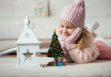 Portrait of pretty girl with new years tree and flashlight Royalty Free Stock Photos