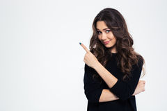 Portrait of a pretty girl pointing finger away Royalty Free Stock Photos