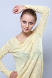 Portrait of pretty girl posing in yellow blouse Royalty Free Stock Photos