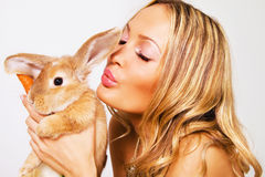 Portrait of a pretty girl with a rabbit. Closeup portrait of a pretty girl with a rabbit Royalty Free Stock Image
