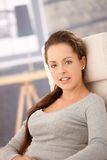 Portrait of pretty girl relaxing at home smiling Royalty Free Stock Photos