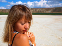 Portrait of pretty girl on a salt lake Stock Photos