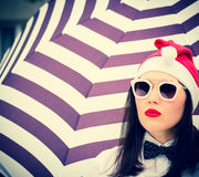 Portrait of a pretty girl in Santa Claus hat and  sunglasses Stock Images