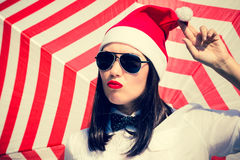 Portrait of a pretty girl in Santa Claus hat Stock Images