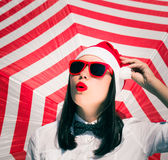 Portrait of a pretty girl in Santa Claus hat and  sunglasses Royalty Free Stock Images