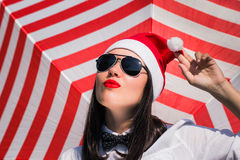 Portrait of a pretty girl in Santa Claus hat and  sunglasses Royalty Free Stock Image