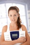 Portrait of pretty girl with scale dieting Stock Image
