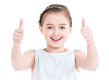 Portrait of a pretty girl showing thumbs up. Stock Photos