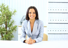 Portrait of pretty girl sitting at desk Royalty Free Stock Photos